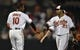 Jun 9, 2014; Baltimore, MD, USA; Baltimore Orioles teammates Adam Jones (10) and Nelson Cruz (23) celebrate after a game against the Boston Red Sox at Oriole Park at Camden Yards. The Orioles defeated the Red Sox 4-0. Mandatory Credit: Joy R. Absalon-USA TODAY Sports