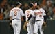 Jun 9, 2014; Baltimore, MD, USA; Baltimore Orioles teammates Ryan Flaherty (3) and Nick Markakis (21) celebrate after a game against the Boston Red Sox at Oriole Park at Camden Yards. The Orioles defeated the Red Sox 4-0. Mandatory Credit: Joy R. Absalon-USA TODAY Sports