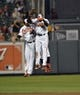 Jun 9, 2014; Baltimore, MD, USA; Baltimore Orioles outfielders Nelson Cruz (left) Nick Markakis (right) and David Lough (rear) celebrate after a game against the Boston Red Sox at Oriole Park at Camden Yards. The Orioles defeated the Red Sox 4-0. Mandatory Credit: Joy R. Absalon-USA TODAY Sports