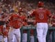Jun 9, 2014; Anaheim, CA, USA; Los Angeles Angels third baseman David Freese (6) is congratulated by right fielder Kole Calhoun (56) after scoring in the fourth inning against the Oakland Athletics at Angel Stadium of Anaheim. Mandatory Credit: Kirby Lee-USA TODAY Sports