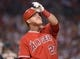 Jun 9, 2014; Anaheim, CA, USA; Los Angeles Angels center fielder Mike Trout (27) reacts during the game against the Oakland Athletics at Angel Stadium of Anaheim. The Angels defeated the Athletics 4-1. Mandatory Credit: Kirby Lee-USA TODAY Sports