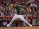 Jun 9, 2014; Anaheim, CA, USA; Oakland Athletics reliever Fernando Abad delivers a pitch against the Los Angeles Angels at Angel Stadium of Anaheim. The Angels defeated the Athletics 4-1. Mandatory Credit: Kirby Lee-USA TODAY Sports