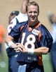 Jun 10, 2014; Denver, CO, USA; Denver Broncos quarterback Peyton Manning (18) warms up during mini camp at the Broncos practice facility. Mandatory Credit: Ron Chenoy-USA TODAY Sports