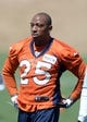 Jun 10, 2014; Denver, CO, USA; Denver Broncos cornerback Chris Harris (25) warms up during mini camp drills at the Broncos practice facility. Mandatory Credit: Ron Chenoy-USA TODAY Sports