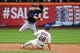 Jun 11, 2014; New York, NY, USA;  New York Mets second baseman Daniel Murphy (28) slides as Milwaukee Brewers second baseman Scooter Gennett (2) completes the double play during the first inning at Citi Field. Mandatory Credit: Anthony Gruppuso-USA TODAY Sports