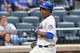 Jun 11, 2014; New York, NY, USA;  New York Mets right fielder Curtis Granderson (3) heads home to score on a sacrifice fly hit by first baseman Lucas Duda (21) (not pictured) during the second inning against the Milwaukee Brewers at Citi Field. Mandatory Credit: Anthony Gruppuso-USA TODAY Sports