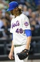 Jun 11, 2014; New York, NY, USA; New York Mets starting pitcher Jacob deGrom (48) heads to the dugout after being relieved during the sixth inning against the Milwaukee Brewers at Citi Field. Mandatory Credit: Anthony Gruppuso-USA TODAY Sports