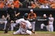 Jun 11, 2014; Baltimore, MD, USA;  Baltimore Orioles first baseman Steve Pearce (28) slides safely home on center fielder Adam Jones (10) rbi double at Oriole Park during the first inning  against the Boston Red Sox at Camden Yards. Mandatory Credit: Tommy Gilligan-USA TODAY Sports