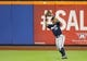 Jun 11, 2014; New York, NY, USA;  Milwaukee Brewers left fielder Khris Davis (18) fields a ball for an out during the seventh inning against the New York Mets at Citi Field. Mandatory Credit: Anthony Gruppuso-USA TODAY Sports