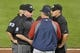 Jun 11, 2014; Baltimore, MD, USA;  Umpire Brian Gorman (9) speaks with Boston Red Sox manager John Farrell (53) during the eighth inning during the game against the Baltimore Orioles at Oriole Park at Camden Yards. Baltimore Orioles defeated Boston Red Sox 6-0. Mandatory Credit: Tommy Gilligan-USA TODAY Sports