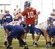 Jun 12, 2014; East Rutherford, NJ, USA; New York Giants quarterback Eli Manning (10) calls a play during New York Giants minicamp at the Quest Diagnostics Training Center. William Perlman/The Star-Ledger-USA TODAY Sports