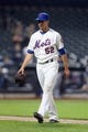 Jun 12, 2014; New York, NY, USA; New York Mets relief pitcher Carlos Torres (52) walks off the field during the thirteenth inning against the Milwaukee Brewers at Citi Field. The Brewers won 5-1 in thirteen innings. Mandatory Credit: Brad Penner-USA TODAY Sports