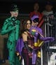 Jun 12, 2014; New York, NY, USA; Fans dressed as Batman characters the Riddler (L) Harley Quinn (M) and Batgirl in the stands during the eighth inning between the New York Mets and the Milwaukee Brewers at Citi Field. The Brewers won 5-1 in thirteen innings. Mandatory Credit: Brad Penner-USA TODAY Sports