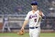 Jun 12, 2014; New York, NY, USA; New York Mets third baseman David Wright (5) walks off the field during a brief rain delay during the eleventh inning against the Milwaukee Brewers at Citi Field. The Brewers won 5-1 in thirteen innings. Mandatory Credit: Brad Penner-USA TODAY Sports