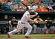 Jun 8, 2014; Baltimore, MD, USA; Baltimore Orioles catcher Nick Hundley (40) bats in the ninth inning against the Oakland Athletics at Oriole Park at Camden Yards. The Athletics defeated the Orioles 11-1. Mandatory Credit: Joy R. Absalon-USA TODAY Sports