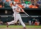 Jun 8, 2014; Baltimore, MD, USA; Baltimore Orioles catcher Nick Hundley (40) bats in the eighth inning against the Oakland Athletics at Oriole Park at Camden Yards. The Athletics defeated the Orioles 11-1. Mandatory Credit: Joy R. Absalon-USA TODAY Sports