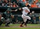 Jun 8, 2014; Baltimore, MD, USA; Baltimore Orioles center fielder David Lough (9) bats in the eighth inning against the Oakland Athletics at Oriole Park at Camden Yards. The Athletics defeated the Orioles 11-1. Mandatory Credit: Joy R. Absalon-USA TODAY Sports
