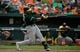 Jun 8, 2014; Baltimore, MD, USA; Oakland Athletics center fielder Yoenis Cespedes (52) singles in the sixth inning against the Baltimore Orioles at Oriole Park at Camden Yards. The Athletics defeated the Orioles 11-1. Mandatory Credit: Joy R. Absalon-USA TODAY Sports