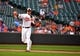 Jun 8, 2014; Baltimore, MD, USA; Baltimore Orioles third baseman Chris Davis (19) throws over to first base in the ninth inning against the Oakland Athletics at Oriole Park at Camden Yards. The Athletics defeated the Orioles 11-1. Mandatory Credit: Joy R. Absalon-USA TODAY Sports