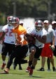 Jun 10, 2014; Tampa Bay, FL, USA;  Tampa Bay Buccaneers quarterback Josh McCown (12) hands the ball off to running back Charles Sims (34) works out for mini camp at One Buccaneer Place. Mandatory Credit: Kim Klement-USA TODAY Sports