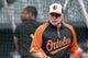Jun 13, 2014; Baltimore, MD, USA; Baltimore Orioles manager Buck Showalter (26) stands outside the batting cage as designated hitter Delmon Young (27) take batting practice prior to the game against the Toronto Blue Jays at Oriole Park at Camden Yards. Mandatory Credit: Tommy Gilligan-USA TODAY Sports