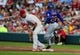 Jun 16, 2014; St. Louis, MO, USA; St. Louis Cardinals first baseman Matt Adams (32) is unable to handle the throw as New York Mets left fielder Eric Young Jr. (22) is safe at first during the third inning at Busch Stadium. Mandatory Credit: Jeff Curry-USA TODAY Sports