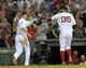 Jun 16, 2014; Boston, MA, USA; Boston Red Sox relief pitcher Burke Badenhop (35) is congratulated by shortstop Stephen Drew (7) after getting out of a bases loaded jam during the eighth inning against the Minnesota Twins at Fenway Park. Mandatory Credit: Bob DeChiara-USA TODAY Sports