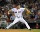 Jun 16, 2014; Boston, MA, USA; Boston Red Sox relief pitcher Koji Uehara (19) pitches during the ninth inning against the Minnesota Twins at Fenway Park. Mandatory Credit: Bob DeChiara-USA TODAY Sports