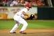 Jun 16, 2014; St. Louis, MO, USA; St. Louis Cardinals third baseman Matt Carpenter (13) fields a ground ball hit by New York Mets catcher Taylor Teagarden (not pictured) during the sixth inning at Busch Stadium. Mandatory Credit: Jeff Curry-USA TODAY Sports