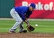 Jun 16, 2014; St. Louis, MO, USA; New York Mets shortstop Ruben Tejada (11) fields ground ball hit by St. Louis Cardinals catcher Yadier Molina (not pictured) during the second inning at Busch Stadium. The Cardinals defeated the Mets 6-2. Mandatory Credit: Jeff Curry-USA TODAY Sports