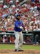 Jun 16, 2014; St. Louis, MO, USA; New York Mets left fielder Eric Young Jr. (22) flips his bat thinking it was ball four during the third inning against the St. Louis Cardinals at Busch Stadium. The Cardinals defeated the Mets 6-2. Mandatory Credit: Jeff Curry-USA TODAY Sports