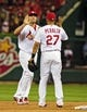 Jun 16, 2014; St. Louis, MO, USA; St. Louis Cardinals left fielder Matt Holliday (7) celebrates with shortstop Jhonny Peralta (27) after defeating the New York Mets at Busch Stadium. The Cardinals defeated the Mets 6-2. Mandatory Credit: Jeff Curry-USA TODAY Sports