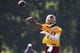 Jun 17, 2014; Ashburn, VA, USA; Washington Redskins quarterback Robert Griffin III (10) throws the ball during minicamp at Redskins Park. Mandatory Credit: Geoff Burke-USA TODAY Sports