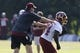 Jun 17, 2014; Ashburn, VA, USA; Washington Redskins head coach Jay Gruden participates in drills with Redskins running back Silas Redd (24) during minicamp at Redskins Park. Mandatory Credit: Geoff Burke-USA TODAY Sports