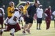 Jun 17, 2014; Ashburn, VA, USA; Washington Redskins head coach Jay Gruden (middle) participates in drills next to Redskins wide receiver Ryan Grant (14) during minicamp at Redskins Park. Mandatory Credit: Geoff Burke-USA TODAY Sports