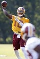 Jun 17, 2014; Ashburn, VA, USA; Washington Redskins quarterback Robert Griffin III (10) throws the ball to Redskins wide receiver Rashad Ross (19) during minicamp at Redskins Park. Mandatory Credit: Geoff Burke-USA TODAY Sports