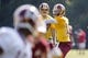 Jun 17, 2014; Ashburn, VA, USA; Washington Redskins quarterback Robert Griffin III (10) throws the ball to Redskins wide receiver Ryan Grant (14) during minicamp at Redskins Park. Mandatory Credit: Geoff Burke-USA TODAY Sports