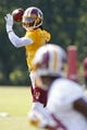Jun 17, 2014; Ashburn, VA, USA; Washington Redskins quarterback Robert Griffin III (10) throws the ball to Redskins wide receiver Aldrick Robinson (15) during minicamp at Redskins Park. Mandatory Credit: Geoff Burke-USA TODAY Sports