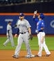 Jun 13, 2014; New York, NY, USA; New York Mets shortstop Ruben Tejada (11) reacts in front of San Diego Padres first baseman Yonder Alonso (23) after doubling during the seventh inning of a game at Citi Field. The Mets defeated the Padres 6-2. Mandatory Credit: Brad Penner-USA TODAY Sports