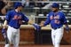 Jun 13, 2014; New York, NY, USA; New York Mets right fielder Bobby Abreu (53) is congratulated by New York Mets catcher Taylor Teagarden (23) after scoring a run against the San Diego Padres during the fourth inning of a game at Citi Field. The Mets defeated the Padres 6-2. Mandatory Credit: Brad Penner-USA TODAY Sports
