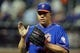 Jun 13, 2014; New York, NY, USA; New York Mets starting pitcher Bartolo Colon (40) claps as he walks off the field after the seventh inning of a game against the San Diego Padres at Citi Field. The Mets defeated the Padres 6-2. Mandatory Credit: Brad Penner-USA TODAY Sports
