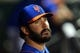 Jun 13, 2014; New York, NY, USA; New York Mets injured starting pitcher Matt Harvey (33) looks on during the fourth inning of a game against the San Diego Padres at Citi Field. The Mets defeated the Padres 6-2. Mandatory Credit: Brad Penner-USA TODAY Sports