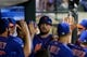 Jun 13, 2014; New York, NY, USA; New York Mets first baseman Lucas Duda (21) is congratulated in the dugout after scoring a run against the San Diego Padres during the fourth inning of a game at Citi Field. The Mets defeated the Padres 6-2. Mandatory Credit: Brad Penner-USA TODAY Sports