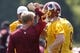 Jun 17, 2014; Ashburn, VA, USA; Washington Redskins quarterback Robert Griffin III (10), Redskins quarterback Kirk Cousins (8), and Redskins quarterback Colt McCoy (16) huddle with offensive coordinator Sean McVay after a minicamp session at Redskins Park. Mandatory Credit: Geoff Burke-USA TODAY Sports