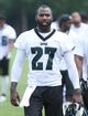 Jun 17, 2014; Philadelphia, PA, USA; Eagles safety Malcolm Jenkins (27) walks off the field at the conclusion of practice at mini camp at the Philadelphia Eagles NovaCare Complex. Mandatory Credit: Bill Streicher-USA TODAY Sports