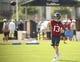 Jun 17, 2014; Houston, TX, USA; Houston Texans quarterback T.J. Yates (13) goes through drills during mini camp at Houston Methodist Training Center. Mandatory Credit: Andrew Richardson-USA TODAY Sports