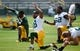 Jun 17, 2014; Green Bay, WI, USA;  Green Bay Packers wide receiver Randall Cobb (18) stretches during the team's minicamp at Ray Nitschke Field. Mandatory Credit: Benny Sieu-USA TODAY Sports