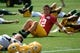 Jun 17, 2014; Green Bay, WI, USA;  Green Bay Packers quarterback Aaron Rodgers stretches during the team's minicamp at Ray Nitschke Field. Mandatory Credit: Benny Sieu-USA TODAY Sports