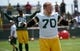 Jun 17, 2014; Green Bay, WI, USA; Green Bay Packers T.J.Lang stretches during the team's minicamp at Ray Nitschke Field. Mandatory Credit: Benny Sieu-USA TODAY Sports