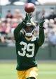Jun 17, 2014; Green Bay, WI, USA;  Green bay Packers cornerback Demetri Goodson catches a pass during the team's minicamp at Ray Nitschke Field. Mandatory Credit: Benny Sieu-USA TODAY Sports